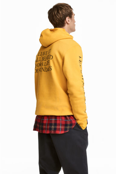 Hooded top with a motif - Yellow - Men | H&M CN 1