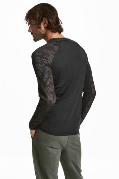 Long-sleeved sports top - Dark green/Patterned - Men | H&M 1