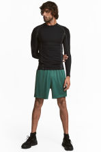 Sports shorts - Green - Men | H&M 1