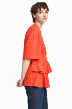 Top en jersey avec volants - Orange - FEMME | H&M FR 1
