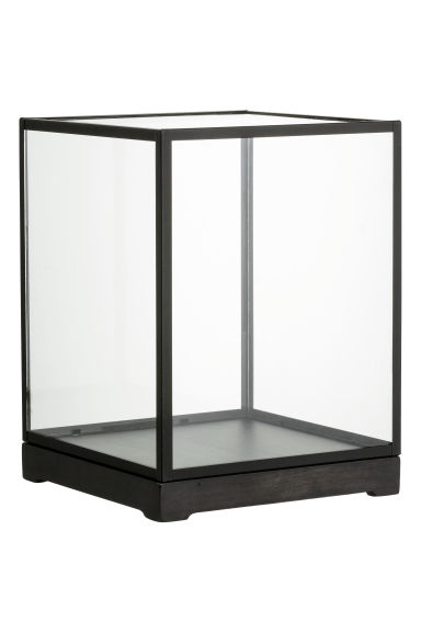 This large, horizontal glass display case is sold as is. It features 2 large shelves and a storage cabinet underneath (access from behind). There is a built in power strip in the back and the case has.