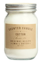 Scented candle in a glass jar - White/Cotton - Home All | H&M GB 1