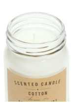 Scented candle in a glass jar - White/Cotton - Home All | H&M GB 2