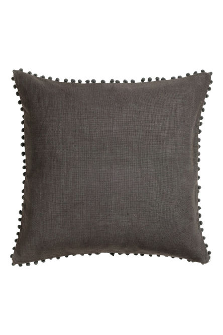 Cushion cover with pompom trim