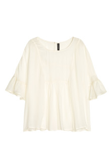 Blouse with frilled sleeves
