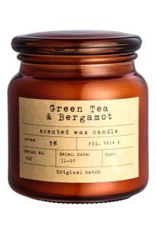 Scented candle in a glass jar