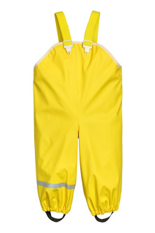 Rain trousers with straps