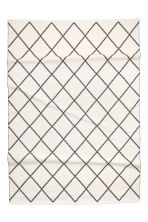 Large jacquard-weave rug - White/Black patterned - Home All | H&M CN 1