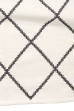 Large jacquard-weave rug - White/Black patterned - Home All | H&M GB 2