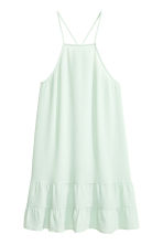 Tiered crêpe dress  - Light mint green - Ladies | H&M CN 1