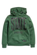 Hooded top with a print motif - Dark green - Kids | H&M CN 2