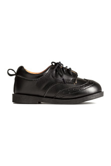 Brogue-patterned shoes