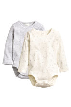 2-pack long-sleeved bodysuits - Natural white/Stars - Kids | H&M CN 1