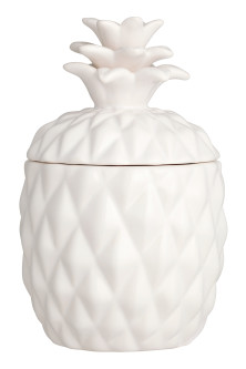 Large candle in a ceramic pot