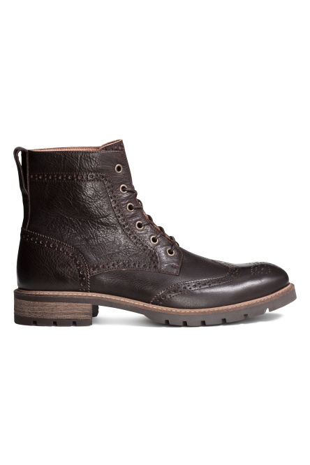 Brogue-patterned leather boots