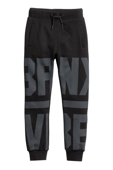 Printed joggers - Black - Kids | H&M CN