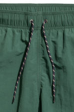Knee-length swim shorts - Dark green - Men | H&M 4