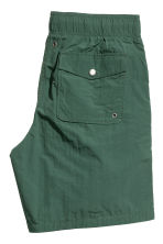Knee-length swim shorts - Dark green - Men | H&M CN 4