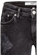 Biker jeans Skinny fit - Black washed out - Ladies | H&M 5