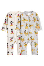2-pack all-in-one pyjamas - Natural white/Mickey Mouse - Kids | H&M 1
