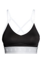 Sports bra Medium support - Black/Silver - Ladies | H&M CN 2