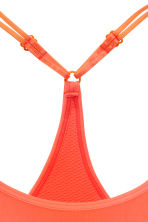 Sports bra Low support - Neon coral - Ladies | H&M CN 3