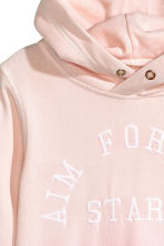 Hooded top with a text motif - Light pink -  | H&M 3