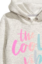 Hooded top with a text motif - Light grey marl -  | H&M 3
