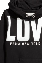 Hooded top with a text motif - Black/New York -  | H&M 3