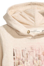 Hooded top with a text motif - Light beige -  | H&M 3