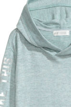 Hooded top with a print motif - Mint green marl -  | H&M CN 3