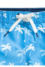 Patterned swim shorts - Blue/Palms - Kids | H&M CN 2