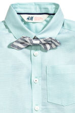 Shirt with a tie/bow tie - Light mint green -  | H&M 3