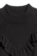 Knitted frilled jumper - Black -  | H&M 3