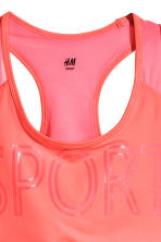 H&M+ Sports bra Medium support - Neon coral - Ladies | H&M CN 3