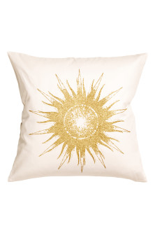 Cushion cover with a sun motif