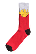 Jacquard-knit socks - Red/French fries - Men | H&M 1