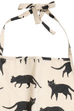 Patterned apron - Natural white/Cats - Home All | H&M CN 2