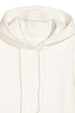 Hooded top with side slits - White - Ladies | H&M CN 3