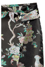 Wrap skirt with metal eyelet - Black/Floral - Ladies | H&M 3