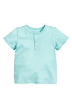 Short-sleeved Henley shirt - Mint green - Kids | H&M CN 1