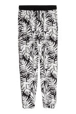 Patterned trousers - Black/Leaf -  | H&M 2