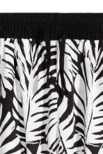 Patterned trousers - Black/Leaf -  | H&M 3