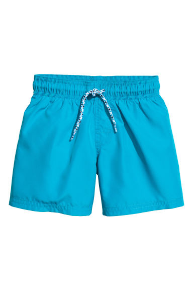 Short swim shorts - Turquoise blue - Kids | H&M 1