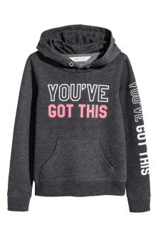 Hooded top with a text motif