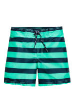 Patterned swim shorts - Mint green/Striped - Kids | H&M CN 1