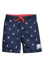 Patterned swim shorts - Dark blue/Palms - Kids | H&M CN 1