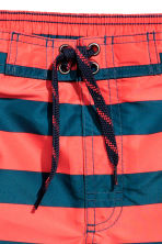 Patterned swim shorts - Coral red/Striped - Kids | H&M CN 2