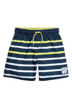 Swim shorts - Dark blue/Yellow - Kids | H&M 1