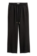 Pantaloni ampi in lyocell - Nero - DONNA | H&M IT 2